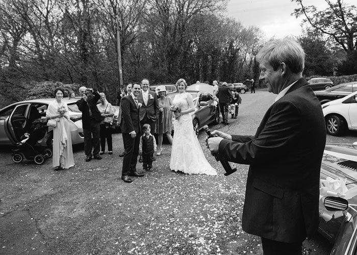 Bottle of champagne being opened at North Wales Wedding ceremony